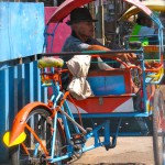 Man on a Colorful Bicycle